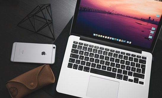 SaaS customer marketing- laptop and cell phone